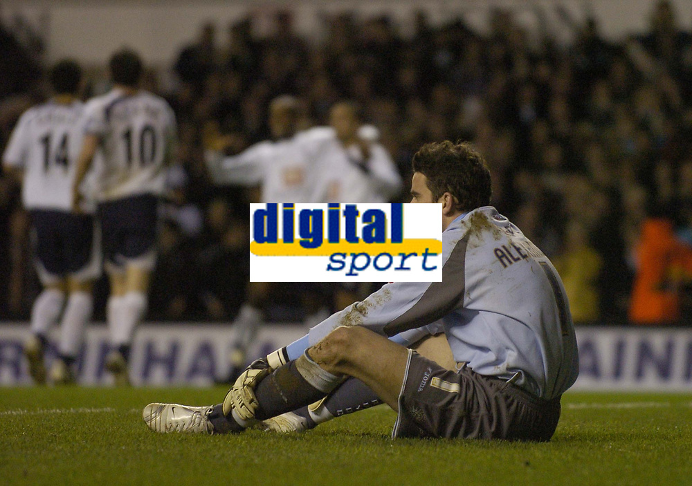 Photo: Olly Greenwood.<br />Tottenham Hotspur v Cardiff City. The FA Cup. 17/01/2007. Cardiff's Neil Alexander looks dejected while Tottenham's Jermaine Defoe celebrates scoring as Spurs score 4