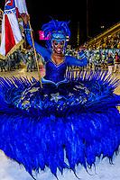 Flag bearer (porta bandeira) in the Carnaval parade of GRES Academicos de Vigario Geral samba school, Sambadrome, Rio de Janeiro, Brazil.