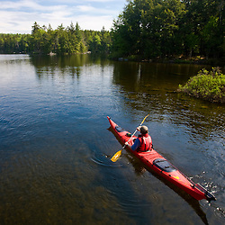 A man kayaks on Branch Lake in Ellsworth, Maine.