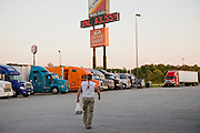 Conrad Tolby walks back to his truck with dinner in a bag at a truck stop at intersection of I-70 and I-57 in Effingham, Illinois.  (Conrad Tolby is featured in the book What I Eat: Around the World in 80 Diets.)  MODEL RELEASED.