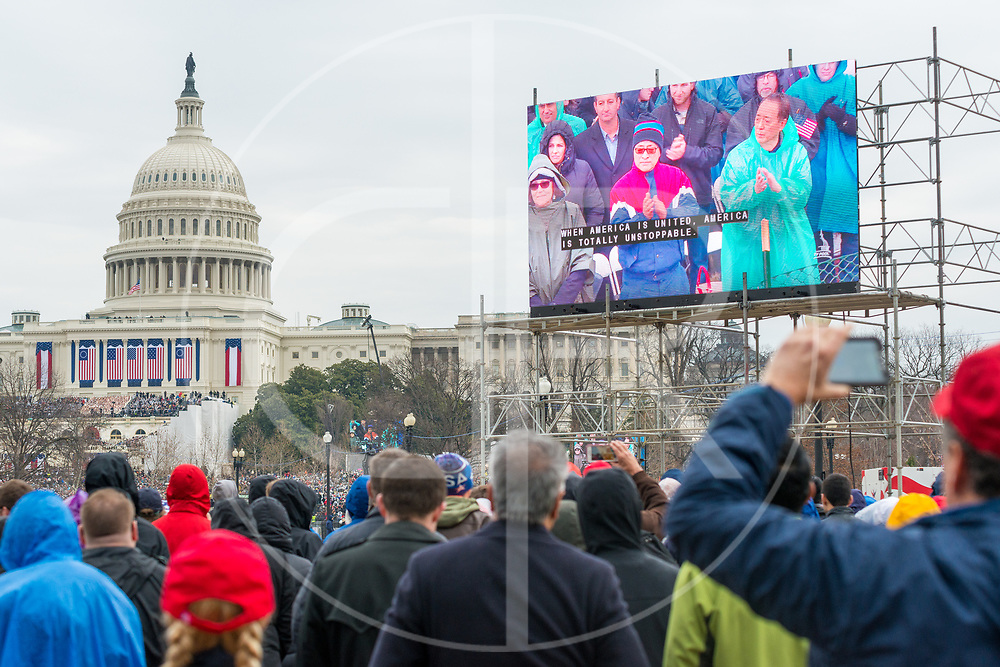 Washington DC, United States - Attendees respond with a round of applause during Trump's inauguration speech.
