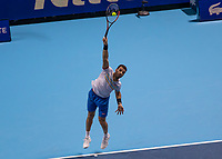 Tennis - 2019 Nitto ATP Finals at The O2 - Day Two<br /> <br /> Doubles Group Max Mirnyi: Kevin Krawietz (GER) & Andreas Mies (GER) Vs. Jean-Julien Rojer (NED) & Horia Tecau (ROM)<br /> <br /> Jean-Julien Rojer (NED) serving <br /> <br /> <br /> COLORSPORT/DANIEL BEARHAM