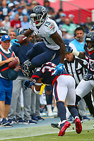 NASHVILLE, TN - SEPTEMBER 16:  Taywan Taylor #13 of the Tennessee Titans jumps over Tyrann Mathieu #32 of the Houston Texans during the first half at Nissan Stadium on September 16, 2018 in Nashville, Tennessee.  (Photo by Frederick Breedon/Getty Images)