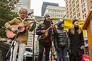 """A group of musicians sings """"This little light of mine"""" to close the rally."""