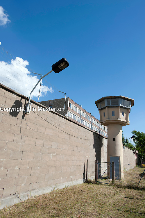 Guard tower and wall at former East German state secret security police or STASI prison at Hohenschönhausen in Berlin Germany