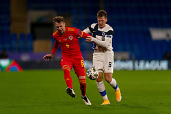 CARDIFF, WALES - Wednesday, November 18, 2020: Wales' Joe Rodon (L) and Finland's Robin Lod during the UEFA Nations League Group Stage League B Group 4 match between Wales and Finland at the Cardiff City Stadium. Wales won 3-1 and finished top of Group 4, winning promotion to League A. (Pic by David Rawcliffe/Propaganda)