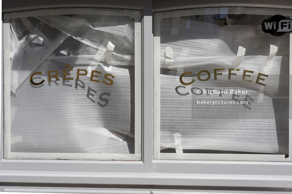 In the 24hrs that a further 38 died from Coronavirus, bringing the total to 41,736, a further easing of the UK's Covid pandemic lockdown restrictions took place with many high street shops today being allowed to re-open after three months of forced closure. One cafe selling coffee and crepes however, remains closed as refurbishments during the loss of business continues, on 15th June 2020, in London, England.