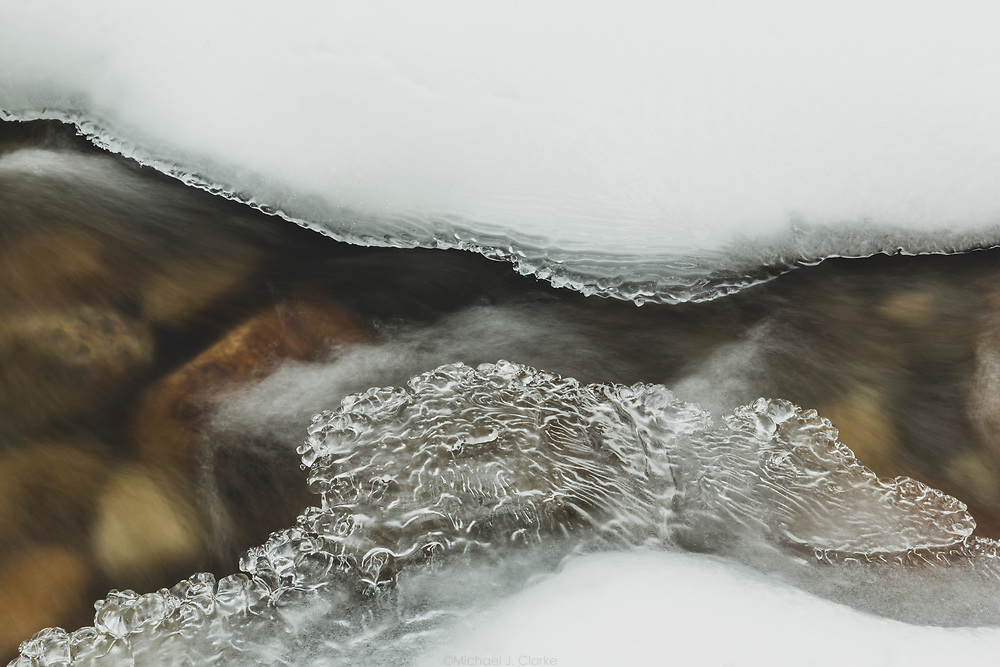 Ice forming over a riverbed on a cold afternoon in New Hampshire's White Mountains.