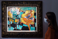 "© Licensed to London News Pictures. 23/07/2020. LONDON, UK. A staff member views ""Danseuse assise dans un fauteuil (1942) by Henri Matisse, estimate: £8-12 million. Preview of works on display at Sotheby's London ahead of a one-off auction on July 28.  Titled 'Rembrandt to Richter', the sale will offer the very best from Old Masters, Impressionist & Modern Art, Modern & Post-War British Art and Contemporary Art.  The exhibition is open to the public at Sotheby's New Bond Street galleries until July 28. [Image embargoed for release until 9am BST 24 July 2020].  Photo credit: Stephen Chung/LNP"