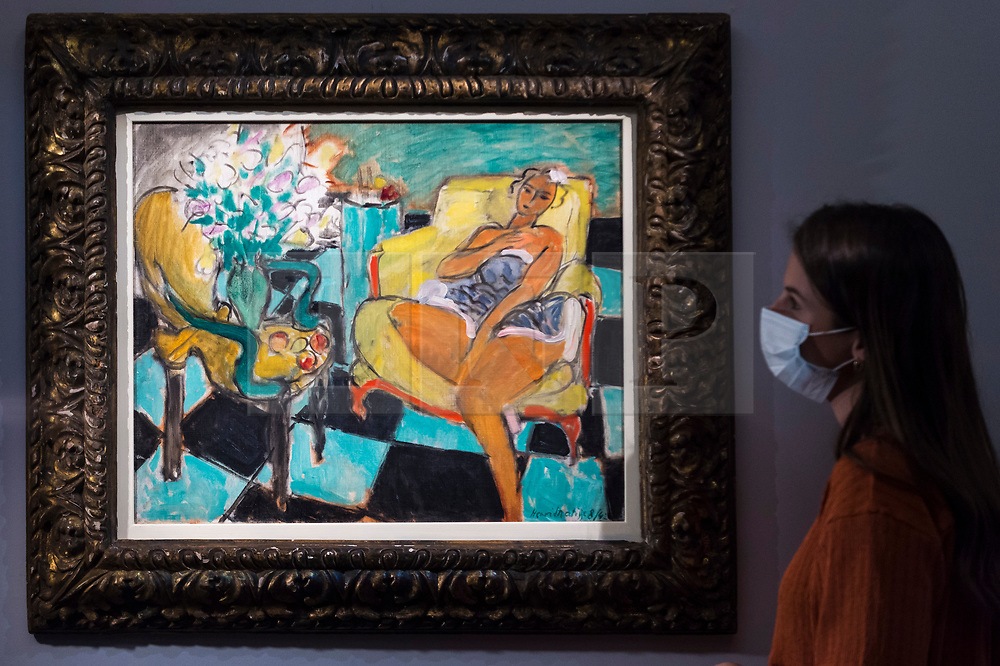"""© Licensed to London News Pictures. 23/07/2020. LONDON, UK. A staff member views """"Danseuse assise dans un fauteuil (1942) by Henri Matisse, estimate: £8-12 million. Preview of works on display at Sotheby's London ahead of a one-off auction on July 28.  Titled 'Rembrandt to Richter', the sale will offer the very best from Old Masters, Impressionist & Modern Art, Modern & Post-War British Art and Contemporary Art.  The exhibition is open to the public at Sotheby's New Bond Street galleries until July 28. [Image embargoed for release until 9am BST 24 July 2020].  Photo credit: Stephen Chung/LNP"""