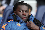 Bafetimbi Gomis of Swansea City looks on from the bench. Barclays Premier league match, Tottenham Hotspur v Swansea city at White Hart Lane in London on Sunday 28th February 2016.<br /> pic by John Patrick Fletcher, Andrew Orchard sports photography.