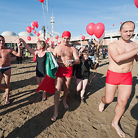 VENICE, ITALY - JANUARY 01:  Swimmers of the Ibernisti walk towards the sea for a dip to celebrate the new year on January 1, 2012 in Venice, Italy. Hundreds of people gather at Lido di Venezia to celebrate the New Year. Following a Viennese waltz, the ibernisti swimmers take a dip in the sea before celebrating on a typical combination of wine, lentils and sausage.