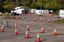 © Licensed to London News Pictures. 19/09/2020. Chessington, UK. NHS Track & Trace workers wait for people to arrive at a quiet Covid-19 testing centre set up in the car park of Chessington World of Adventures south west of London. The Government have faced criticism over delays in getting tested for the COVID-19 strain of coronavirus. . Photo credit: Peter Macdiarmid/LNP