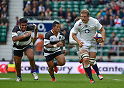 England lock Joe Launchbury (Wasps) makes a break as Barbarians prop Matias Diaz (Pampas & Argentina) gives chase during the International Rugby Union match England XV -V- Barbarians at Twickenham Stadium, London, Greater London, England on May  31  2015. (Steve Flynn/Image of Sport)