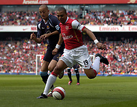 Photo: Olly Greenwood.<br />Arsenal v West Ham United. The Barclays Premiership. 07/04/2007. Arsenal's Gilberto and West Ham's Bobby Zamora
