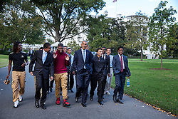 President Barack Obama walks on the South Lawn of the White House with participants of a mentee résumé workshop, Oct. 14, 2014.  (Official White House Photo by Pete Souza)<br /> <br /> This official White House photograph is being made available only for publication by news organizations and/or for personal use printing by the subject(s) of the photograph. The photograph may not be manipulated in any way and may not be used in commercial or political materials, advertisements, emails, products, promotions that in any way suggests approval or endorsement of the President, the First Family, or the White House.