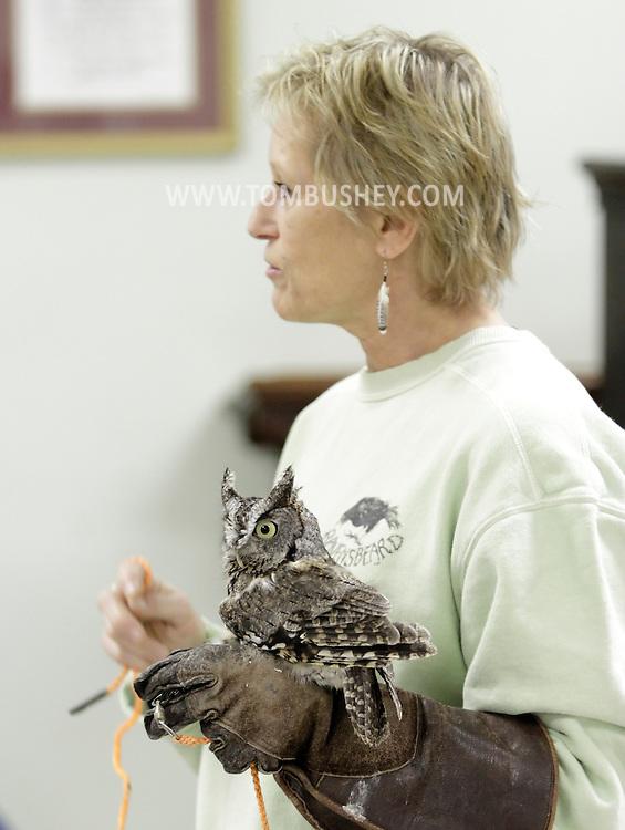 Wurtsboro, New York  - Ellen Kalish of the Ravensbeard Wildlife Rehabilitation Center holds a screech owl (Otus asio) during a live bird demonstration at the Wurtsboro Winterfest on Feb. 11, 2012. The program was presented by the Basha Kill Area Association. ©Tom Bushey / The Image Works