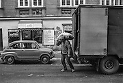 A man is unloading a truck with potatoes in Borivojova street.