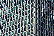 Street view of a large office building in Canary Wharf, Docklands, London, United Kingdom. Canary Wharf is a major business district and financial sector.