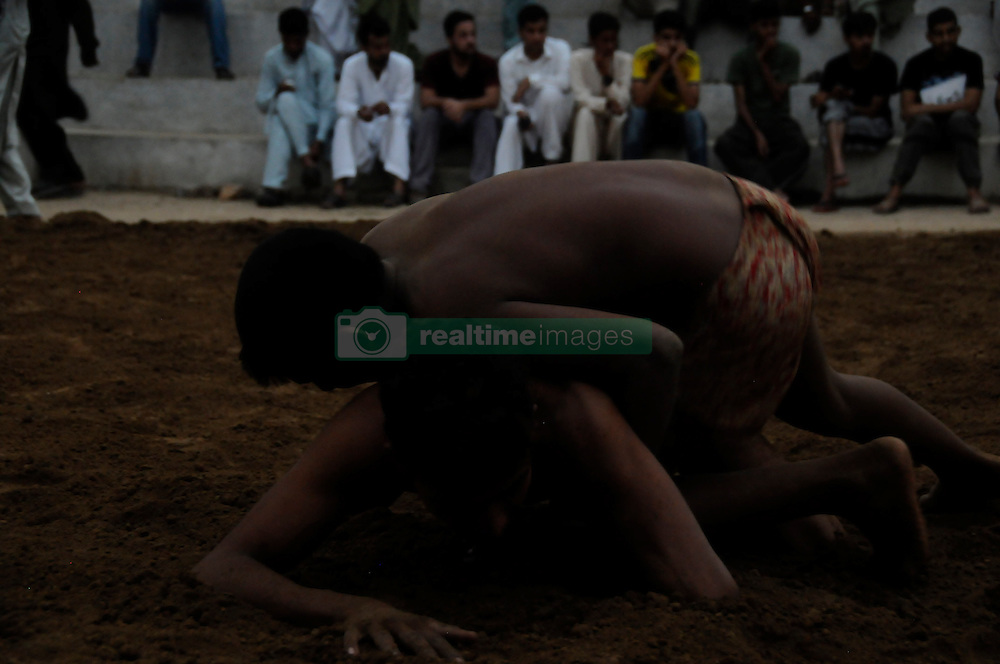 September 23, 2016 - Rawalpindi, Punjab, Pakistan - Pakistani traditional wrestlers or ''Pehlwans'' get ready for a competition during a tournament in Rawalpindi. Kushti (traditional wrestling) is among the most popular games in subcontinent. Traditional Kushti tournaments are held in Pakistan during the annual festivals towns fairs. Wrestlers practiced in Akharas daily to enhance their energies and to learn more and more techniques to be used in the competitions or tournaments in which they participate. (Credit Image: © Zubair Ahmed/Pacific Press via ZUMA Wire)