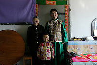 Meng Shujing (82) with grandson Shi Junguang (30) and great-grandson Shi Yaobin (5) at home in Sanjiazi near the town of Qiqihar in Heilongjiang province in North-east China photographed on March 3rd 2007..They are among the last Manchu speakers (less than 100 in the world).