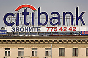 Moscow, Russia, 17/03/2005..Advertising for Citibank on the roof of a central Moscow apartment building. Many Russian cities, and in particular Moscow, are plastered with foreign advertsing which contrasts with the surrounding Soviet era architecture.