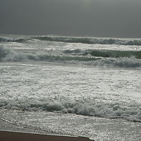 Waves roll into a beach at Point Reyes National Seashore in California.