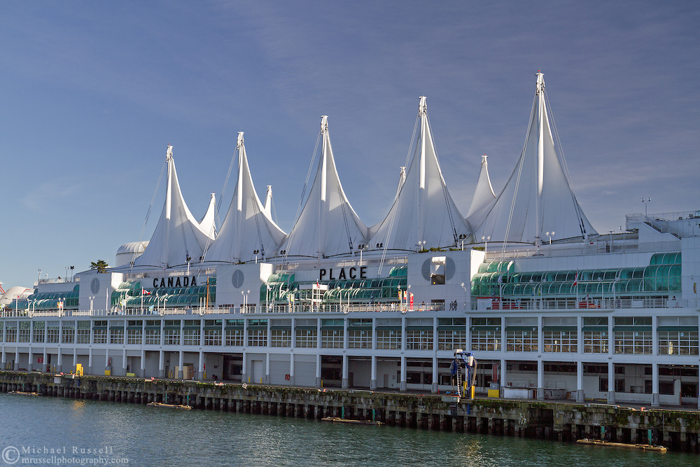 Canada Place is a Vancouver trade and convention center as well as a cruise ship terminal and dock.  Photographed from the newer Vancouver Trade and Convention Center in Vancouver, British Columbia, Canada.