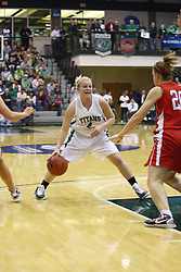 18 March 2011:  Brittany Hasselbring works her way around the top of the key during an NCAA Womens basketball game between the Washington University Bears and the Illinois Wesleyan Titans at Shirk Center in Bloomington Illinois.