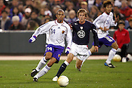 10 February 2006: Japan's Alessandro Santos (14) is chased by Brian Carroll (25), of the United States. The United States Men's National Team defeated Japan 3-2 at SBC Park in San Francisco, California in an International Friendly soccer match.