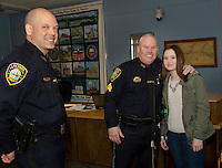 Chief Chris Adams congratulates Detective Kevin Butler with his daughter Kaelyn following the pinning ceremony during Laconia Police Commissioners meeting at City Hall Thursday afternoon.  (Karen Bobotas/for the Laconia Daily Sun)
