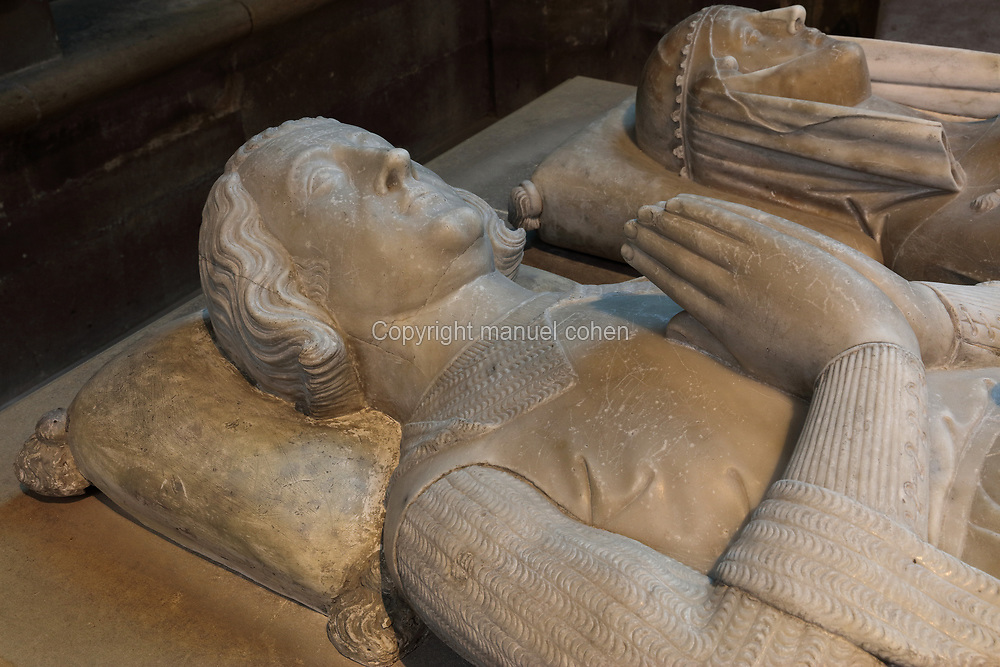 Effigies from the tomb of Marguerite d'Artois, d. 1311, wife of Louis de France, daughter of Philippe d'Artois, wearing a chin guard, and Louis de France, 1275-1319, count of Evreux, son of Philippe III the Bold, in the Basilique Saint-Denis, Paris, France. Both were commissioned in the early 14th century for the Eglise des Jacobins in Paris and moved to Saint-Denis in 1817. The basilica is a large medieval 12th century Gothic abbey church and burial site of French kings from 10th - 18th centuries. Picture by Manuel Cohen