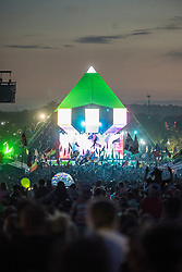 The crowd watch Ed Sheeran performing on the Pyramid Stage during the Glastonbury Festival at Worthy Farm in Pilton, Somerset. Picture date: Sunday June 25th, 2017. Photo credit should read: Matt Crossick/ EMPICS Entertainment.