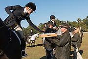 Riders enjoy an early morning sherry before the Blessing of the Hounds marking the start of the Fox Hunting season at Middleton Place Plantation November 27, 2016 in Charleston, SC. Fox hunting in Charleston is a drag hunt using a scented cloth to simulate a fox and no animals are injured.