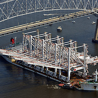 Freighter from China with cranes passing under the Francis Scott Key Bridge in Baltimore Harbor.