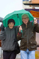 © Licensed to London News Pictures. 09/05/2015. Brighton, UK. Members of the public shelter from the rain and strong winds under their umbrella in Brighton, Today Saturday May 9th 2015 Photo credit : Hugo Michiels/LNP