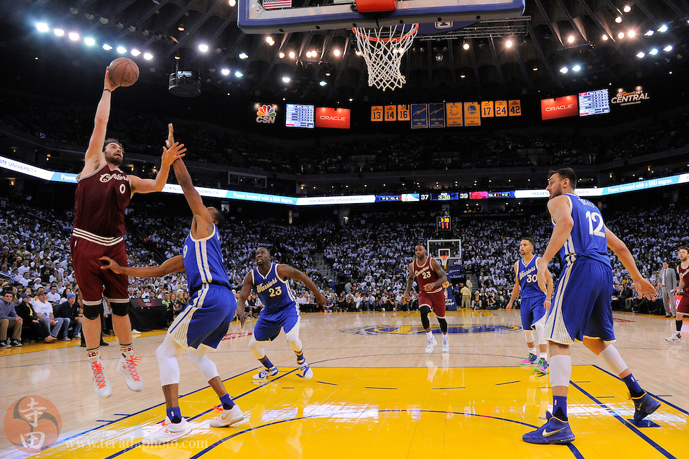 December 25, 2015; Oakland, CA, USA; Cleveland Cavaliers forward Kevin Love (0) shoots the basketball against Golden State Warriors forward Andre Iguodala (9) during the second quarter in a NBA basketball game on Christmas at Oracle Arena. The Warriors defeated the Cavaliers 89-83.