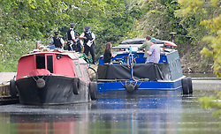 © Licensed to London News Pictures. 09/05/2021. London, UK. Police officers at the scene near the canal at Old Oak Lane, near Harlesden, North West London, where the body of a baby was discovered in the water this afternoon. Photo credit: Ben Cawthra/LNP