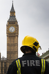 Westminster, London, March 29th 2017. One week after the terror attack on Westminster bridge, it is once again the scene of an emergency services operation as police, ambulance and fire crews search the river after a person jumped from the bridge. The person has not so far been recovered.<br /> PICTURED:  Big ben looms over a firefighter as he scans the waters of the Thames.<br /> CREDIT: ©Paul Davey<br /> FOR LICENCING CONTACT: Paul Davey +44 (0) 7966 016 296 paul@pauldaveycreative.co.uk