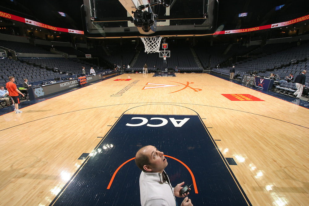 Andrew Shurtleff sets up remote cameras before the North Carolina game against Virginia in Charlottesville, Va. North Carolina defeated Virginia 54-51.