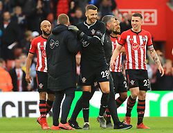 Southampton goalkeeper Angus Gunn (centre) celebrates with team-mates after the final whistle