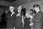 26/09/1962<br /> 09/26/1962<br /> 26 September 1962<br /> 40th Anniversary Party for Maidenform Inc., at the Gresham Hotel, Dublin. Picture shows blowing out the birthday cake (l-r): Mrs Robert Briscoe; Mr Robert Briscoe T.D.; Mrs Ida Rosenthal, Chairman of the Board of Maidenform and Mr John McGuire, Managing Director of Brown Thomas and Co. Ltd..