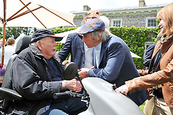 Left to right, LORD MONTAGUE OF BEAULIEU and SIR JACKIE STEWART at a luncheon hosted by Cartier for their sponsorship of the Style et Luxe part of the Goodwood Festival of Speed at Goodwood House, West Sussex on 1st July 2012.