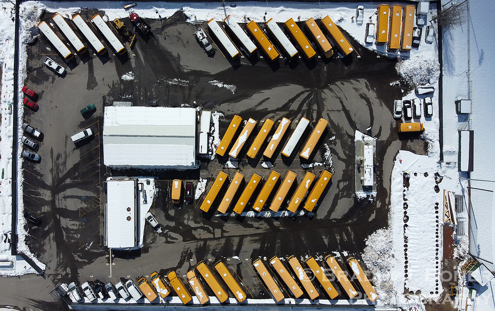 The Teton County School District's fleet of school buses sit idle after schools were closed in March due to the coronavirus pandemic. TCSD officials decided in early May to keep students home for the remainder of the school year.