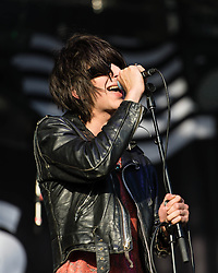 © Licensed to London News Pictures. 08/06/2014. London, UK.   The Horrors performing live at FIeld Day 2014.  In this picture - Faris Badwan.  The Horrors are an English indie rock band composed of members lead vocalist Faris Badwan, guitarist Joshua Hayward, keyboardist and synthesiser player Tom Cowan, bassist Rhys Webb and drummer and percussionist Joe Spurgeon. Photo credit : Richard Isaac/LNP
