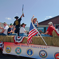 A Tea Party conservative brandishes his rifle during the Fourth of July parade in Butte, Montana.