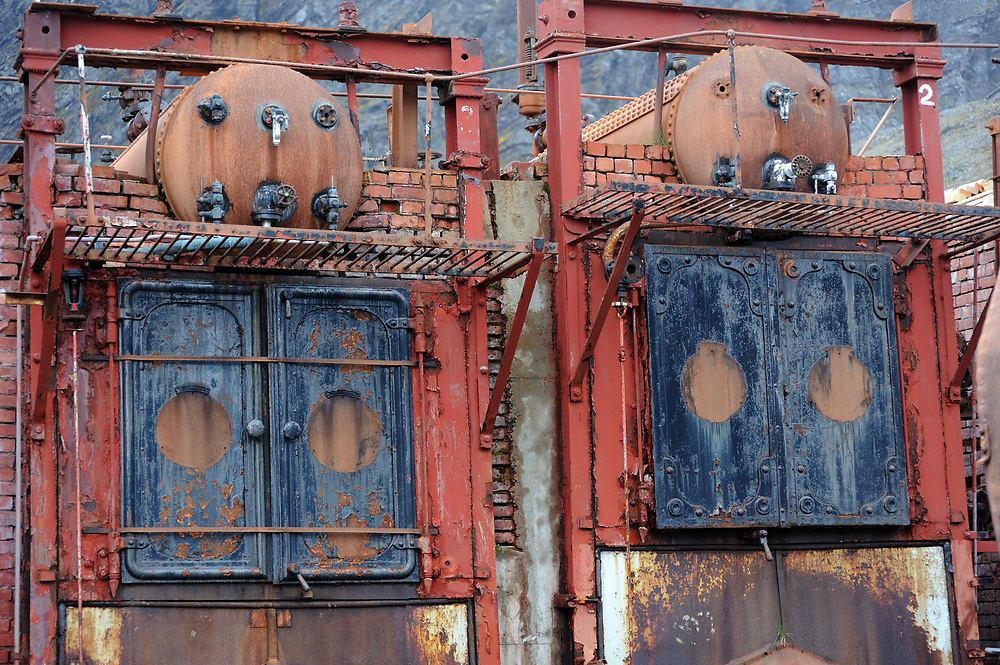 Rusting ovens in the  the ruins of the whaling station. They were used for rendering  whale and seal carcasses in the production of oil.   Grytviken, King Edward Cove, .South Georgia.  20Feb16