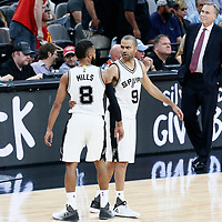 03 May 2017: San Antonio Spurs guard Patty Mills (8) is seen next to San Antonio Spurs guard Tony Parker (9) during the San Antonio Spurs 121-96 victory over the Houston Rockets, in game 2 of the Western Conference Semi Finals, at the AT&T Center, San Antonio, Texas, USA.