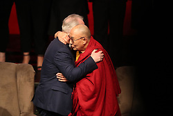 The Dalai Lama hugs Children in Crossfire CEO Richard Moore at the Millennium Forum, during a visit to Londonderry.