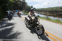 Karlee Cobb rides her custom 2015 Indian Scout in Tamoka State Park during Daytona Beach Bike Week  2015. FL, USA. Friday, March 13, 2015.  Photography ©2015 Michael Lichter.